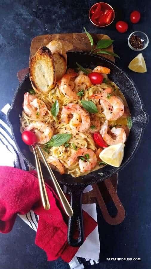 serving shrimp scampi pasta with garnishes on the side