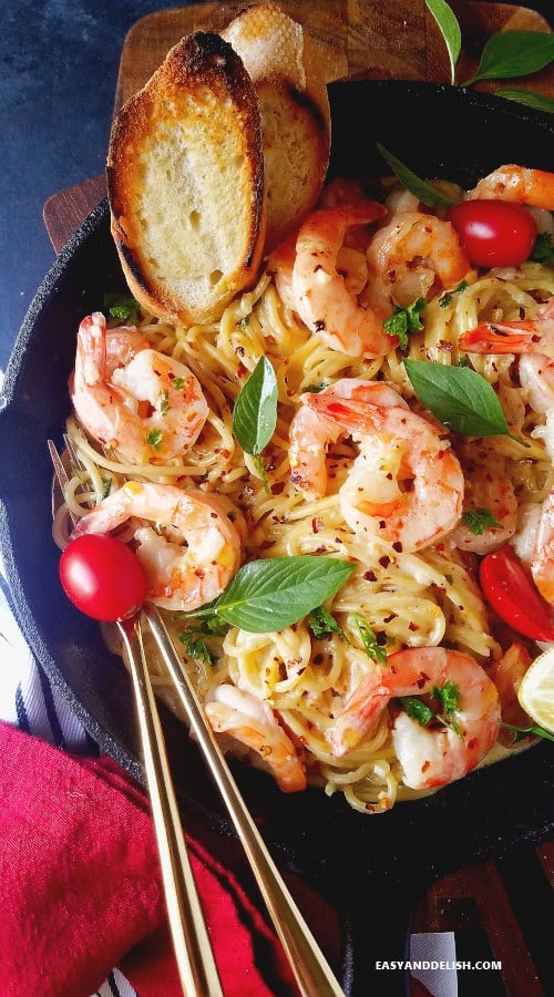 shrimp scampi with pasta and toasted baguette on the side