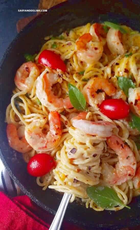 rolling pasta and shrimp scampi with a fork