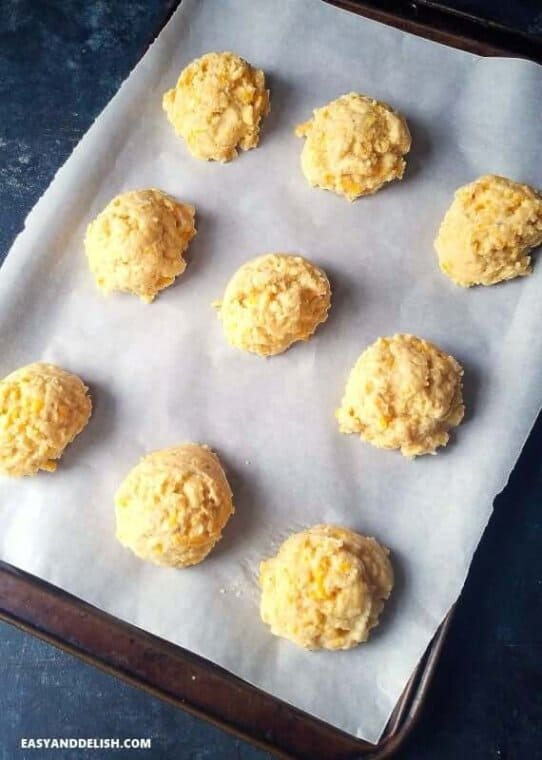 Paleo biscuits scooped onto a bakinh sheet before being abked