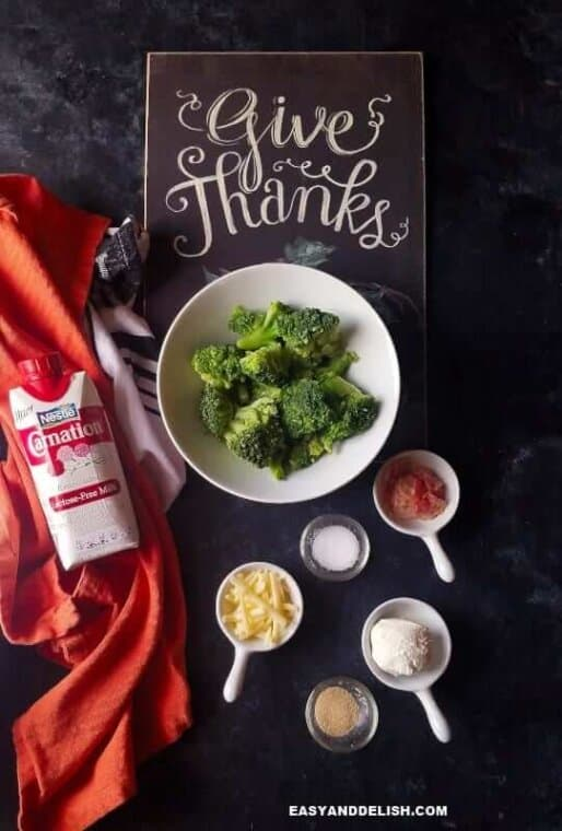 "ingredients for broccoli au gratin on a table with ""Give Thanks"" sign on the back"