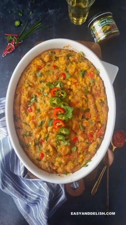 Mexican cornbread casserole with spoons on the side