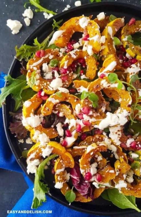 close up image showing half of a bowl with roasted delicata squash