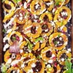 roasted delicata squash in a baking pan