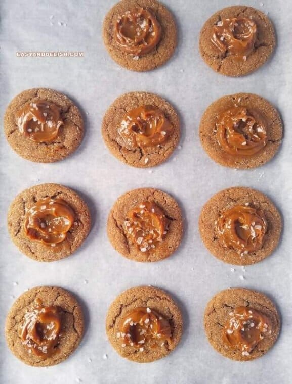 several salted dulce de leche cinnamon cookies on a lined baking sheet