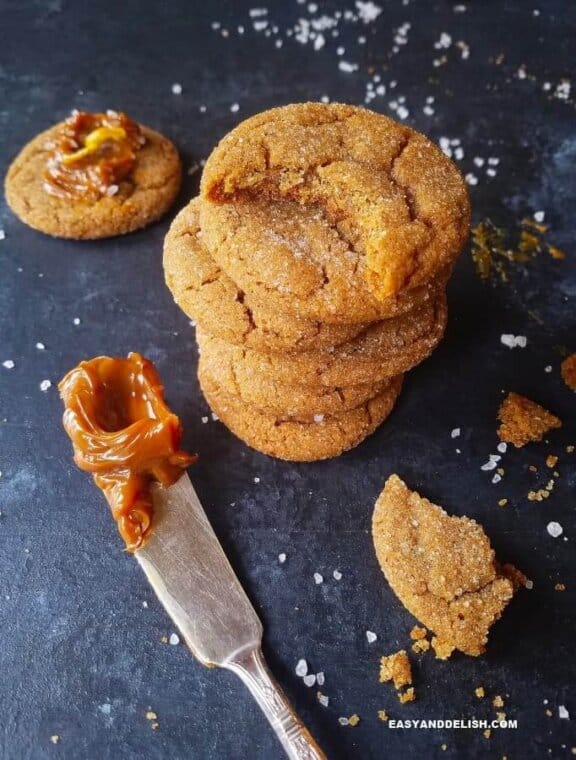 cinnamon cookies piled up with salt and a dulce de leche spatula on the side