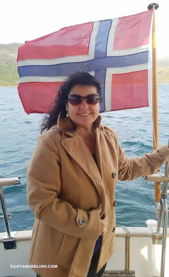 a woman with a Norwegian flag on the background