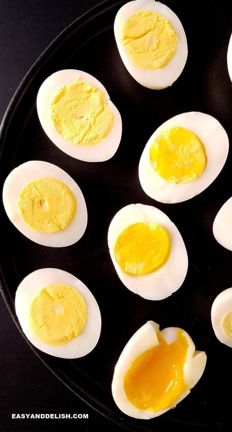 soft, medium and hard boiled eggs ina platter