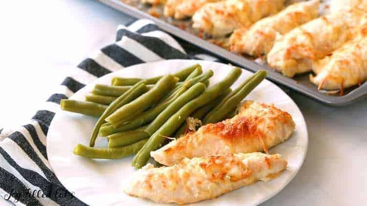 chicken tenders with green beans in a plate