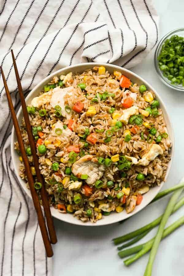 chicken fried rice in a bowl with chopsticks on the side as one of easy one pot meals for dinner