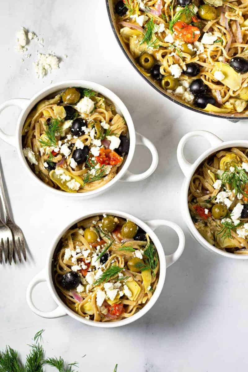 Mediterranean pasta in several ramekins or bowls as one of the easy one pot meals for dinner