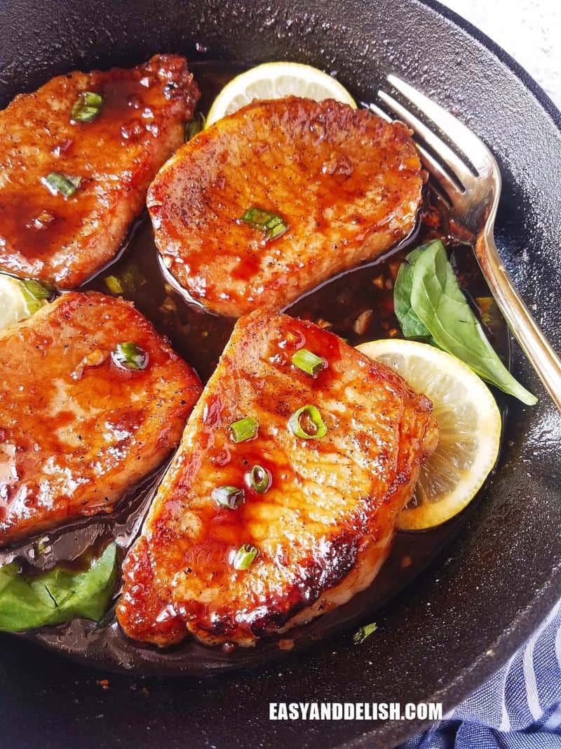 boneless pork chops with teriyaki sauce in a cast iron pan