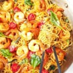 close up of garlic shrimp spaghetti in a pan