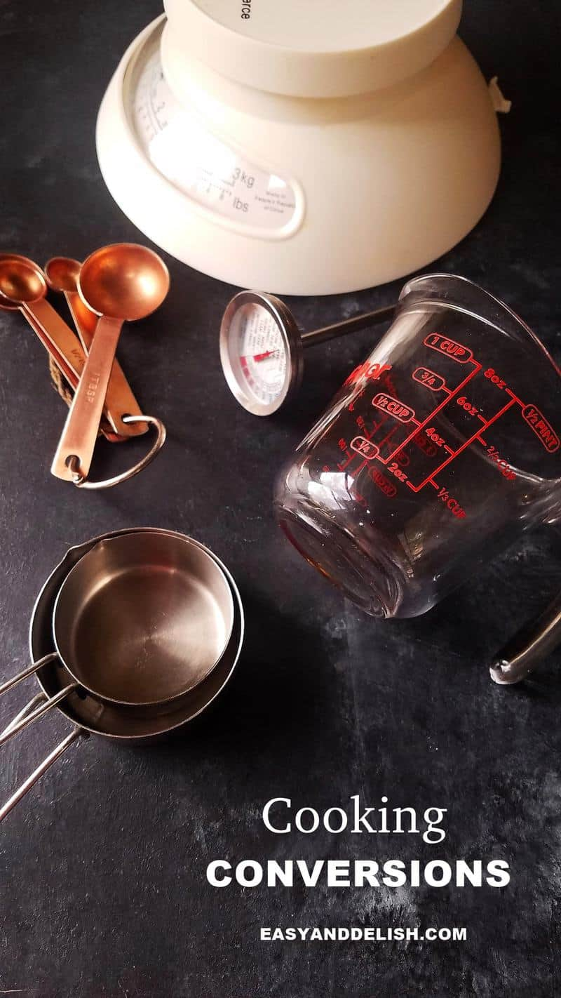 several cooking conversions tools such as scale, measurement cups and spoons, thermometer, etc