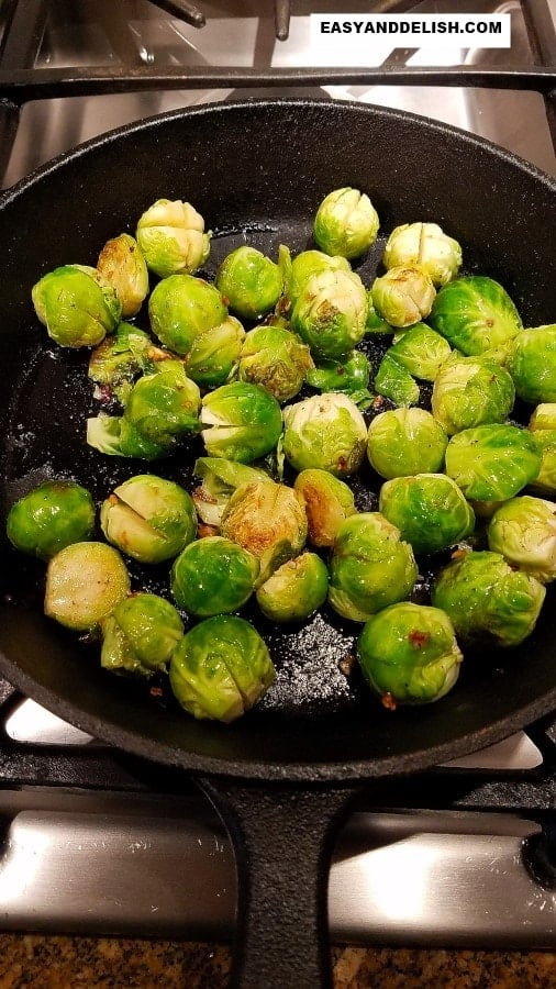 vegetables being sauteed in a skillet