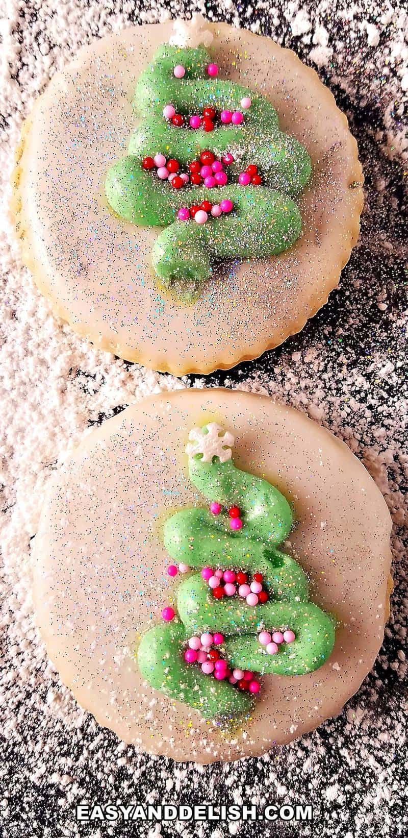 close up of two Christmas ccookies on a surface