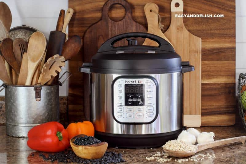 Instant Pot on a kitchen surface with food and cutting boards