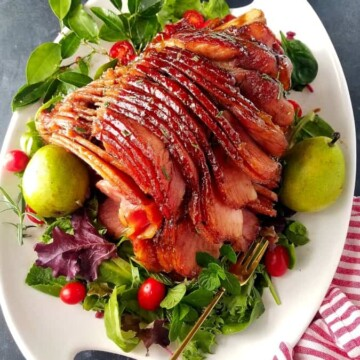 Honey Baked Ham on a platter with garnishes