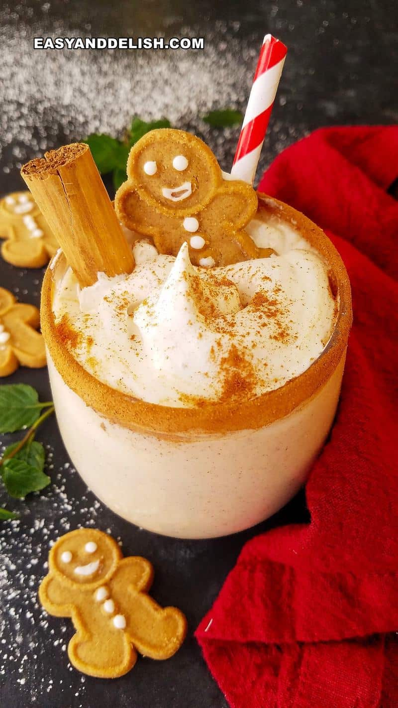 close up of a holiday drink in a glass wwith gingerbread man cookies