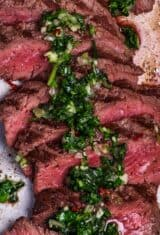 sliced marinated carne asada with chimichurri sauce