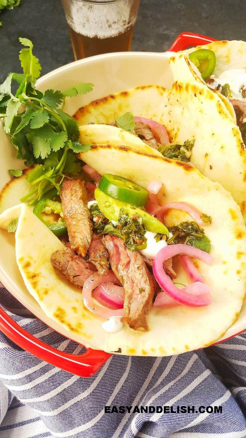 several marinated skirt steak tacos in a bowl