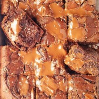 sliced fudgy brownies in a pan