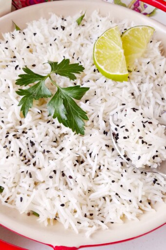a bowl of basmati rice with garnishing on top