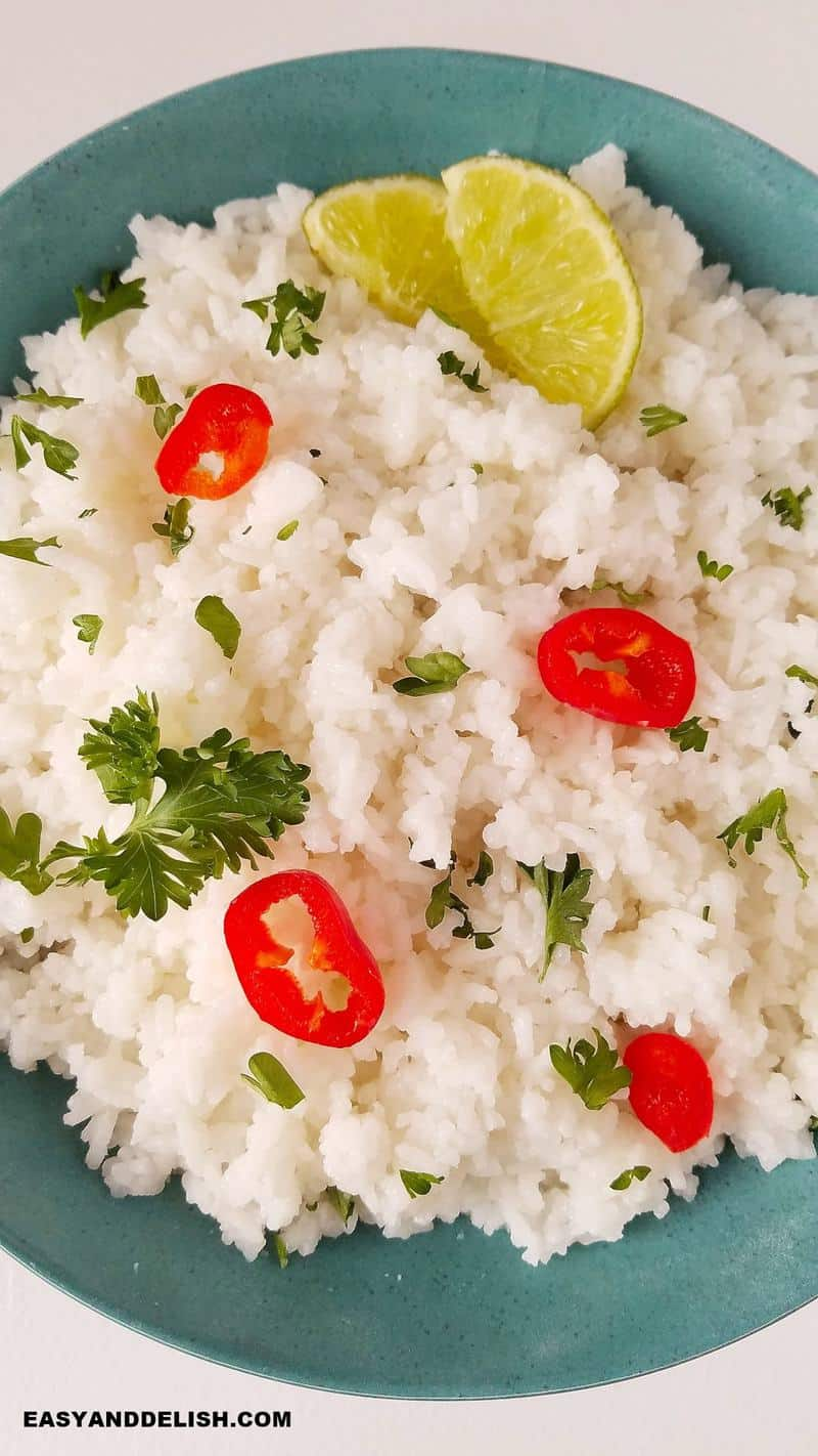 Close up of Instant Pot Jasmine Rice in a bowl topped with sliced chillies and limes