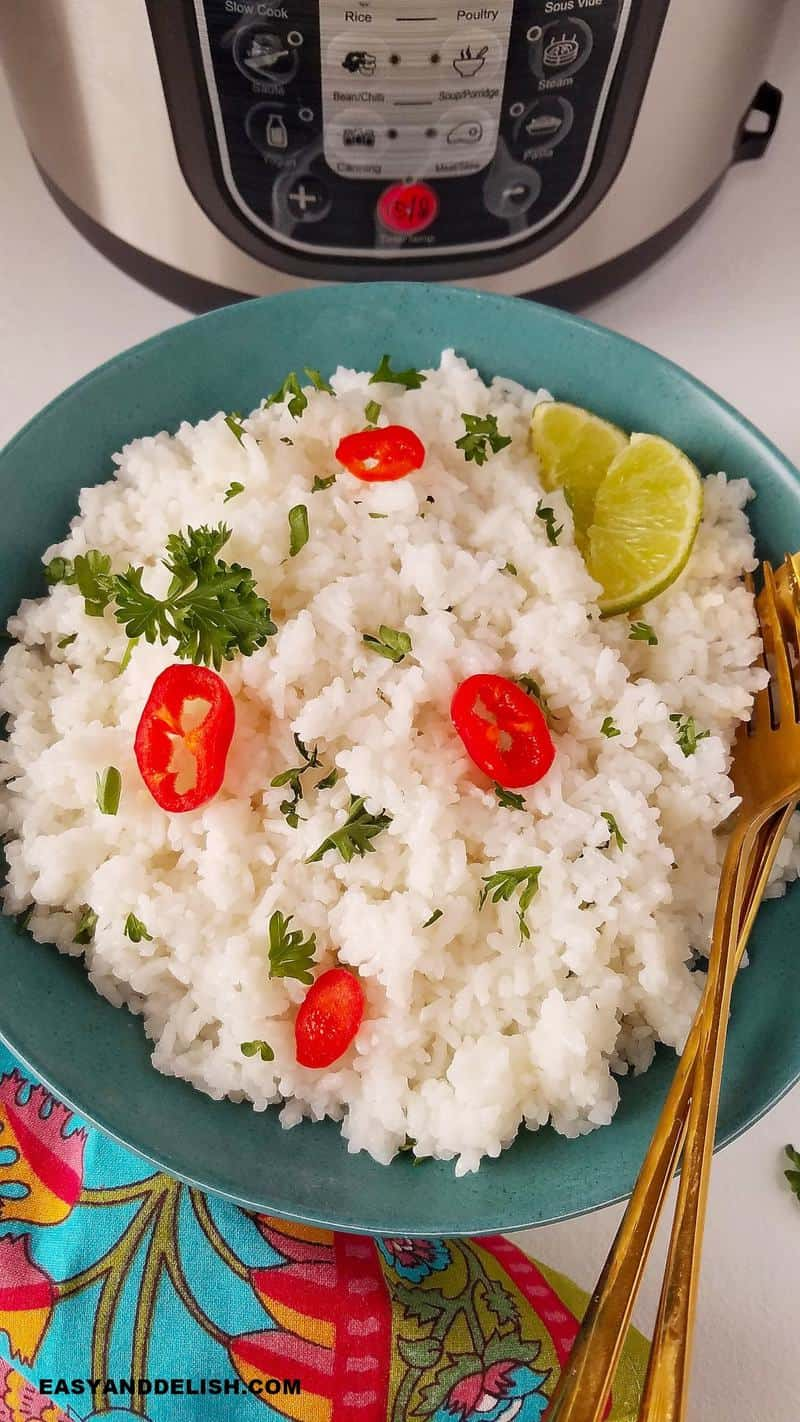 cooked jasmine rice with pressure cooekr in the background