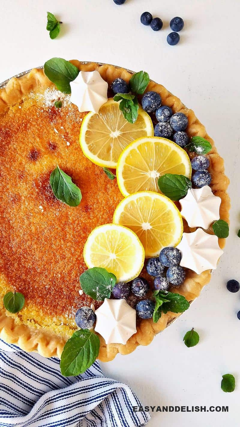 lemon chess pie topped with berries and meringues