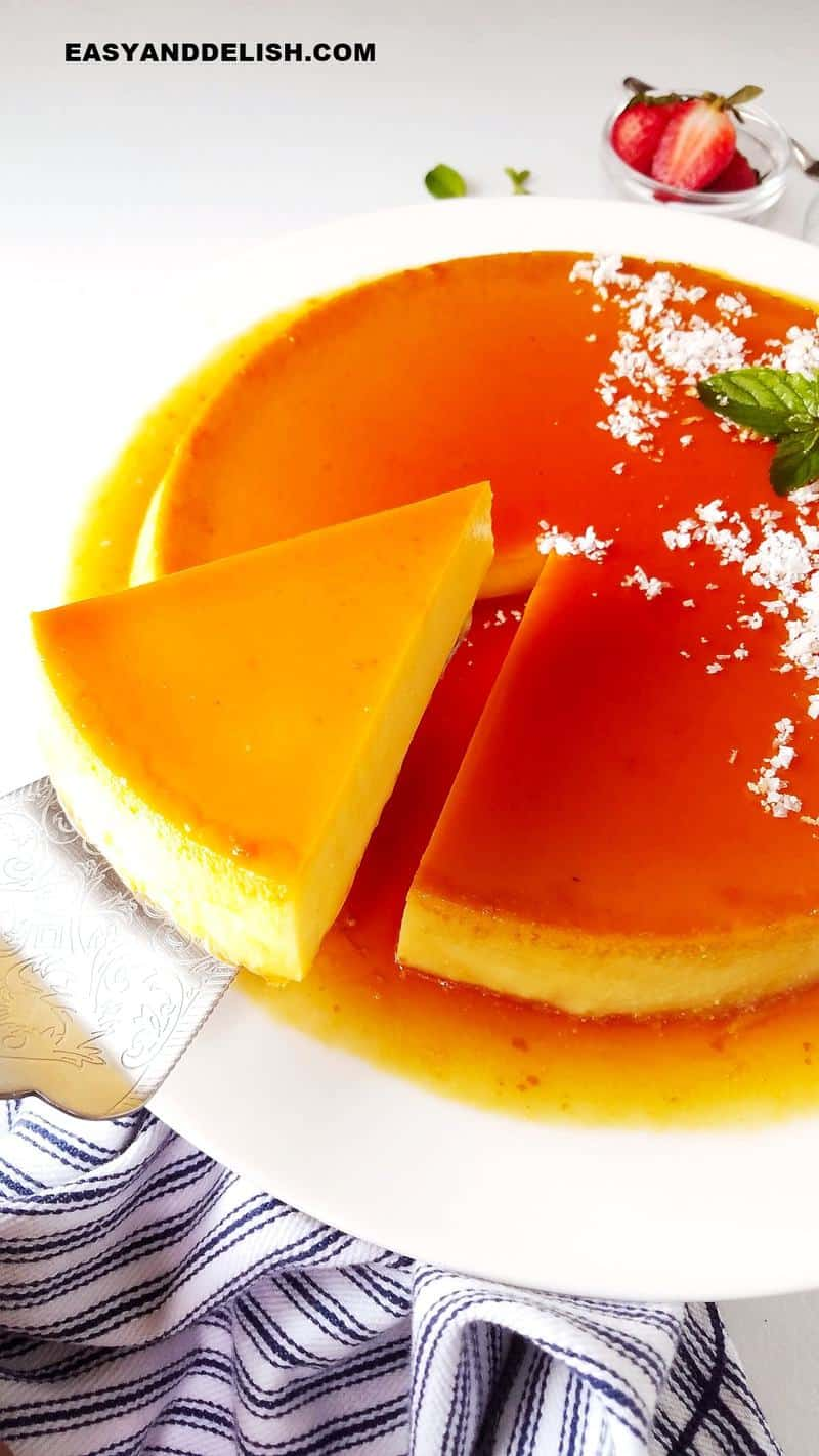 a slice of coconut flan being lifted