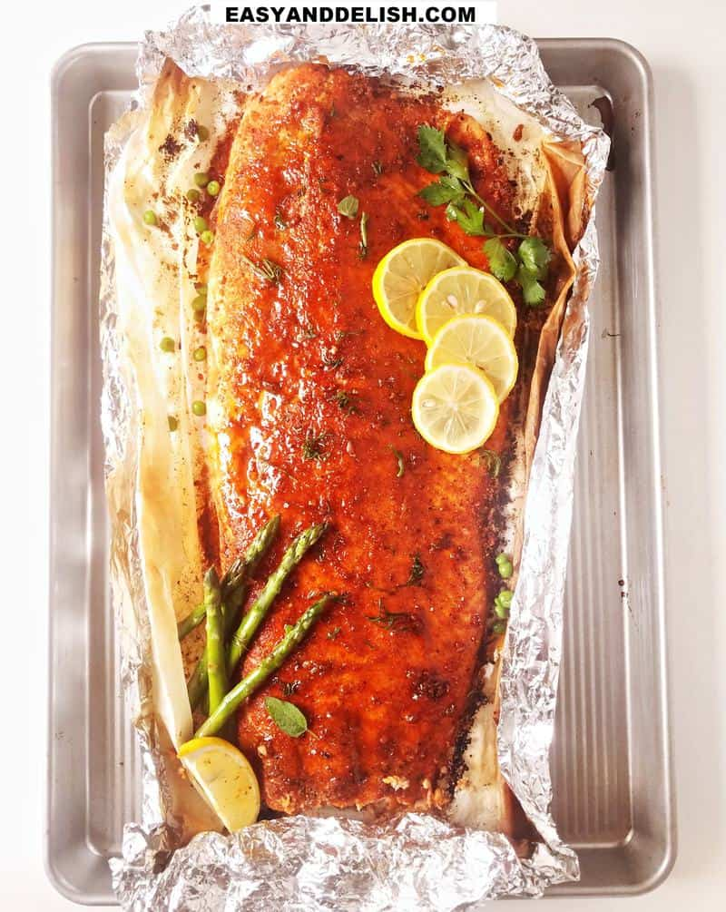baked salmon whole with garnishes on top