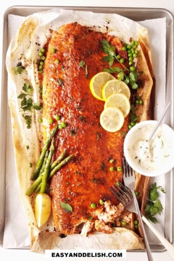 baked blackened salmon on a tray with garnishes