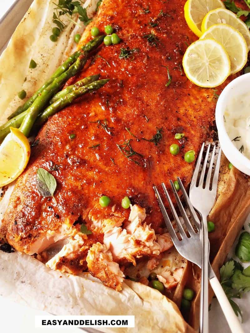 close up of baked blackened salmon flaked on the side