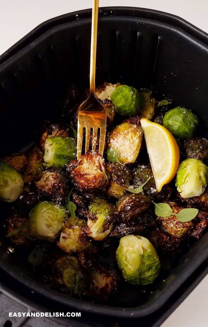 brussels sprouts in air fryer with a fork