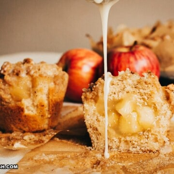 whole and cut in half drizzled apple crumble muffins