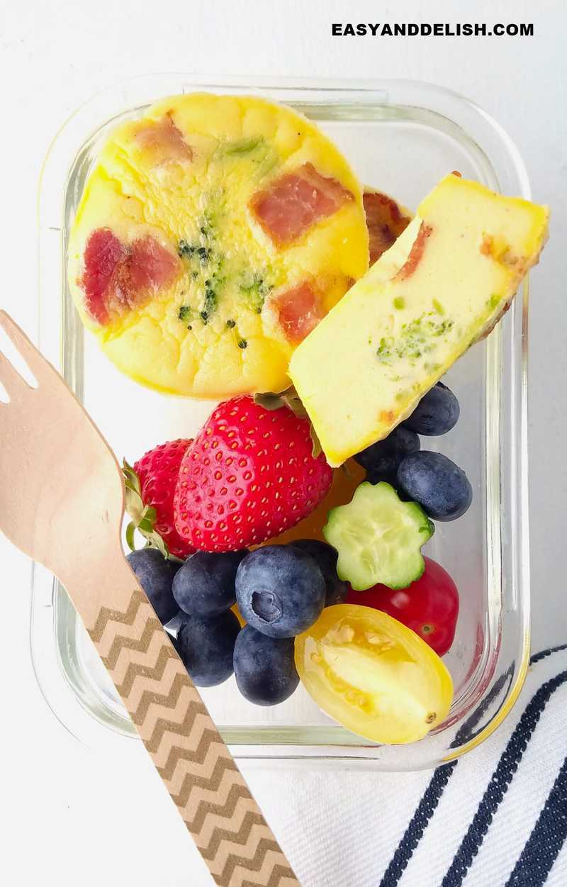small lunch box with breakfast egg muffins and fruits